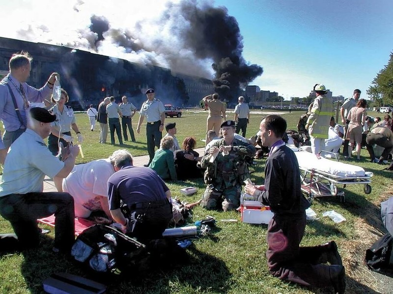 Fr. Mcgraw prays with victims of the Pentagon attack on 9/11/2001