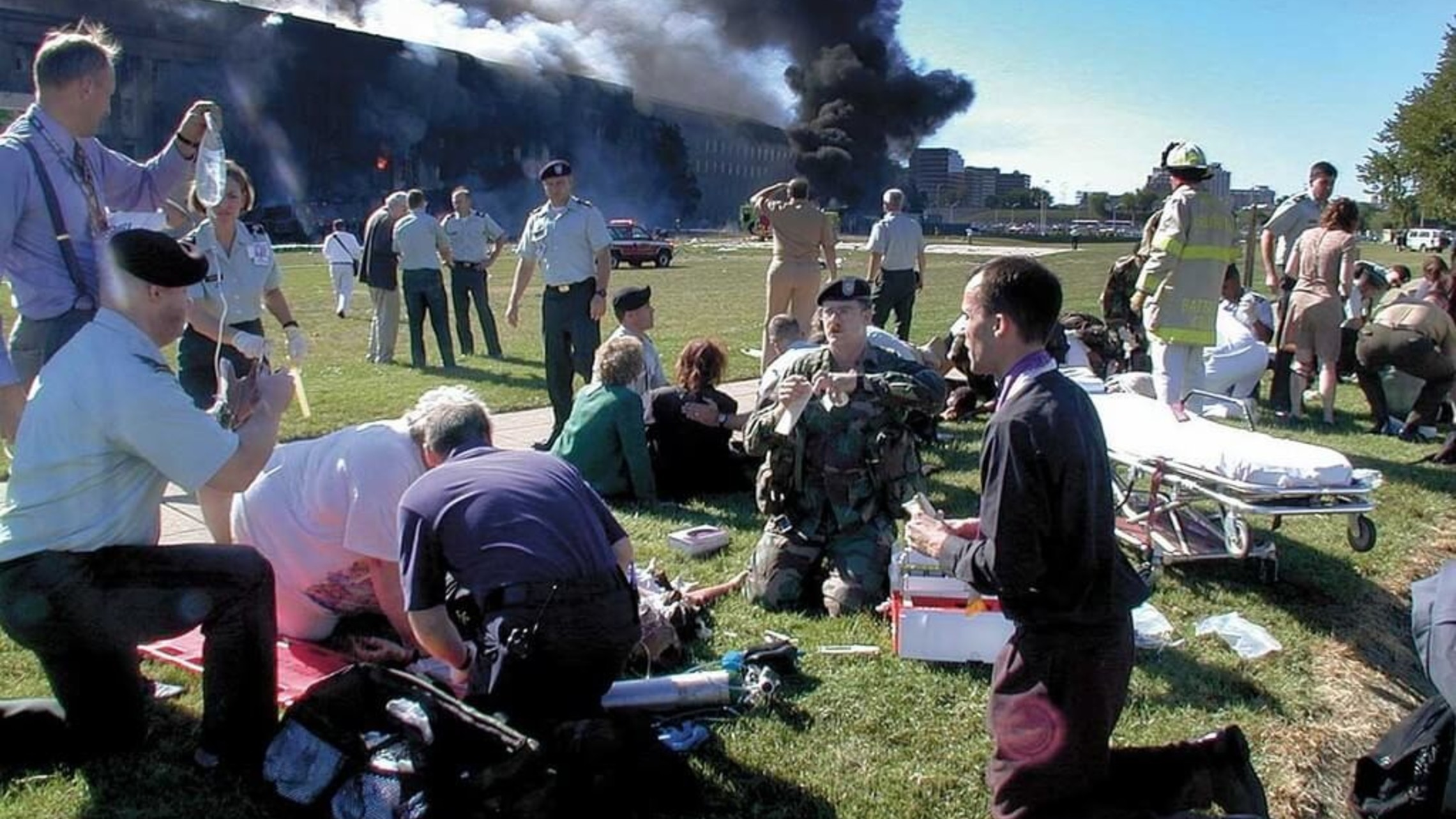 Fr. Steven McGraw prays with victims outsdide the Pentagon on 9/11/2001