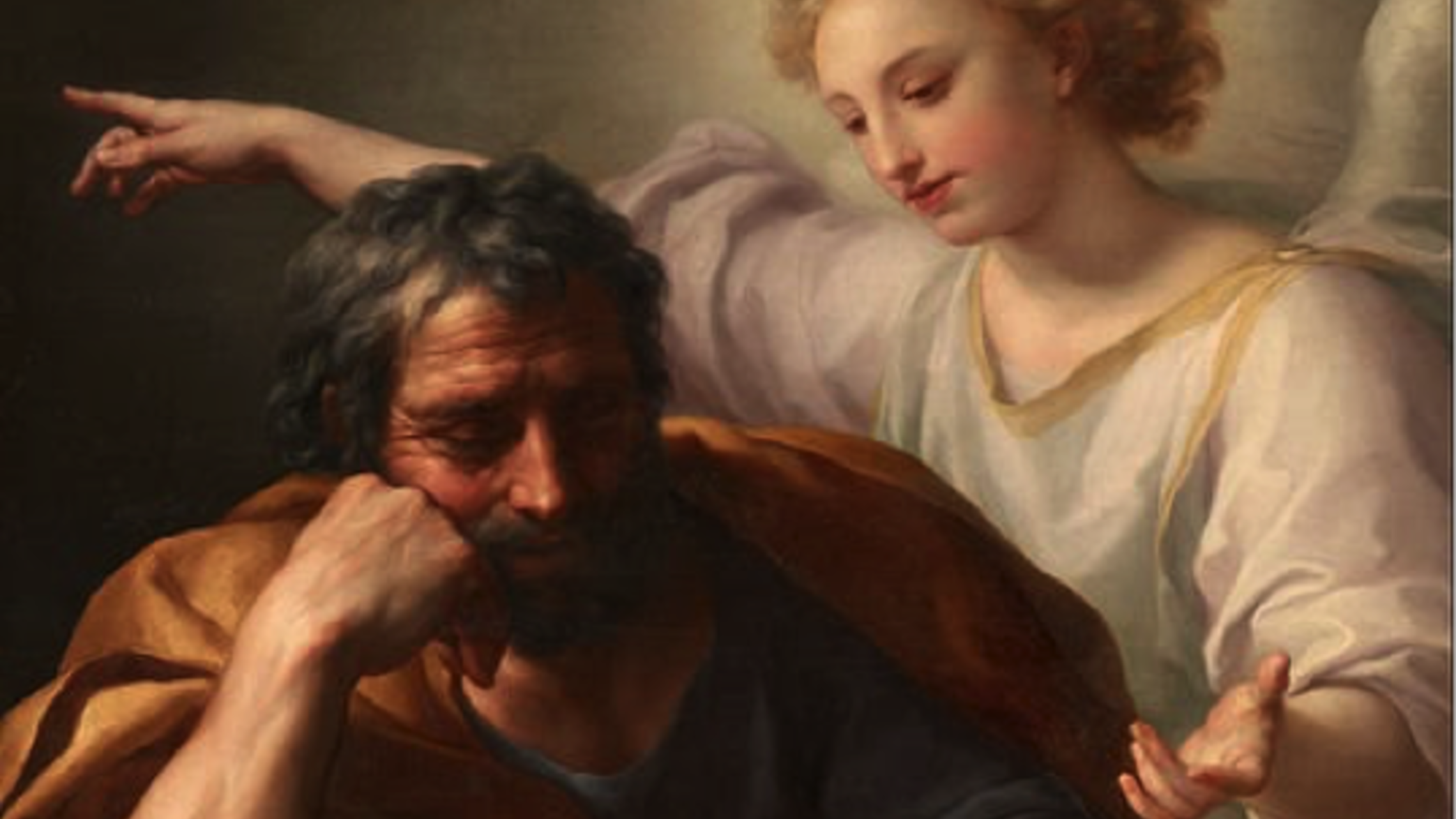 St. Joseph sits in thought with an Angel